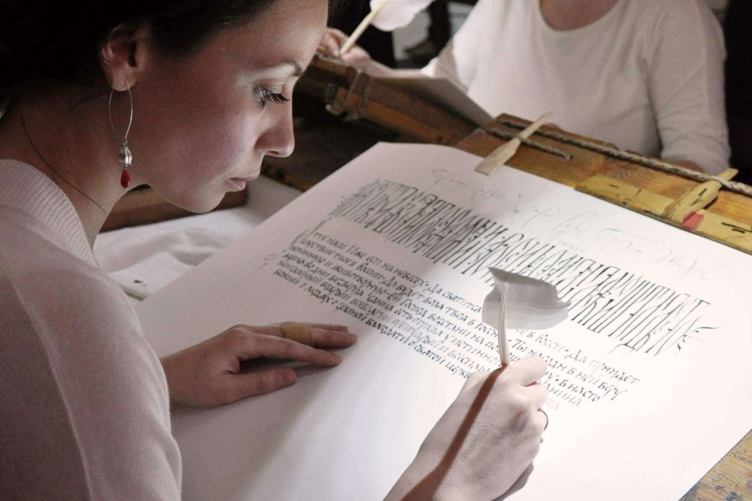 Tatiana Iakovleva working on her calligraphy