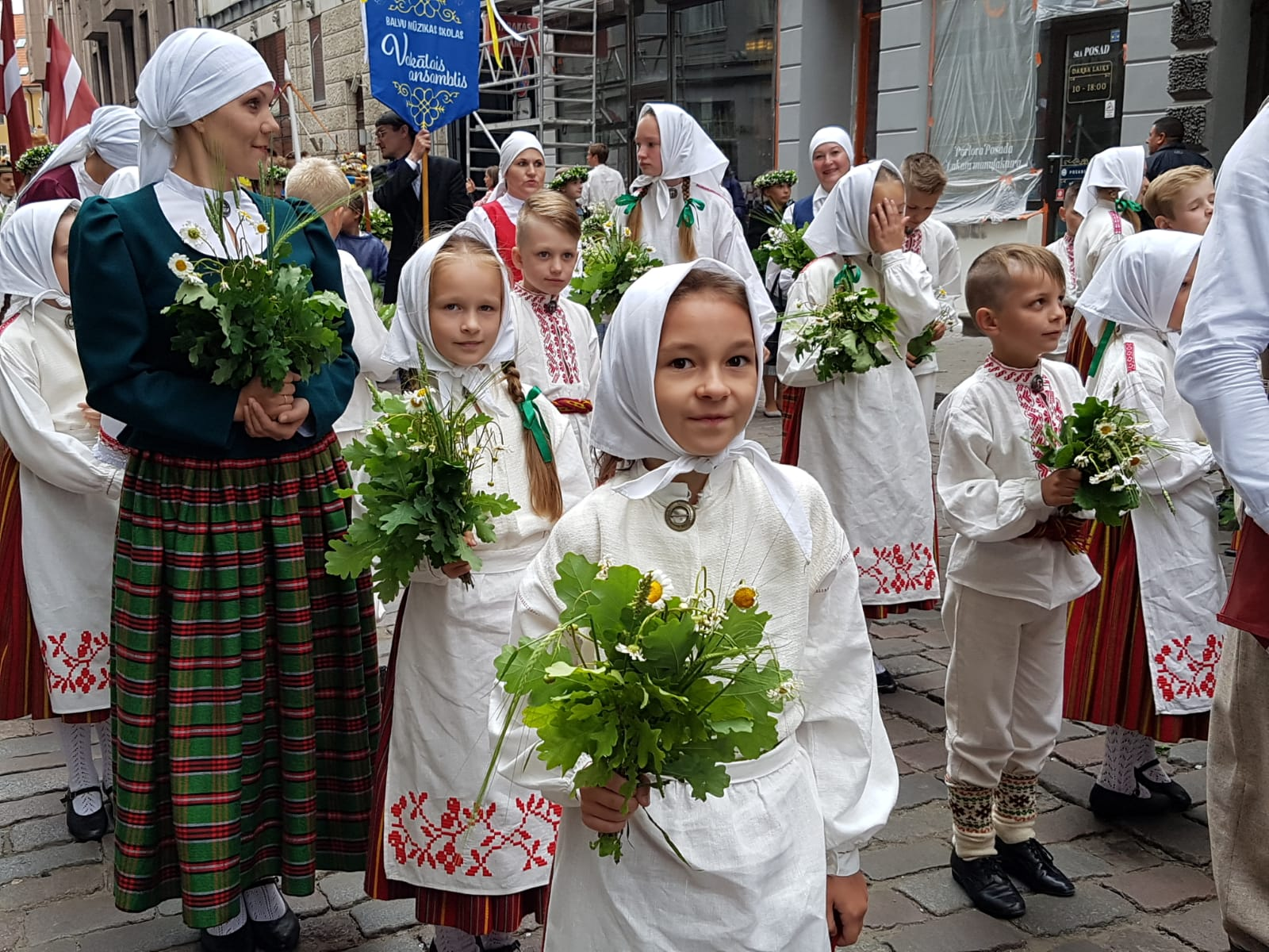 children in national costumes at procession